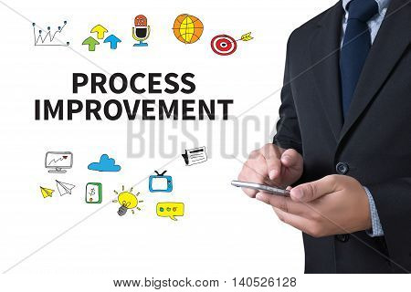 PROCESS IMPROVEMENT businessman working use smartphone computer top