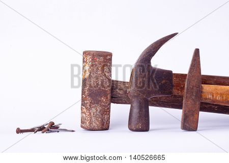 old Traditional curved claw hammer and Tack hammer and Sledge hammer and rust nail tack used on white background tool isolated
