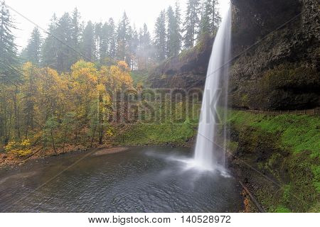 South Falls at Silver Falls State Park in Oregon during Autumn one foggy morning