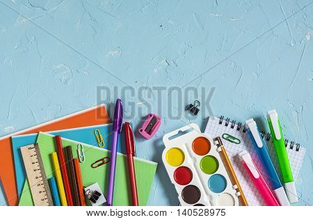School supplies and accessories on a blue background. Free space for text. Top view. Education background