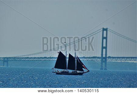 tall ship sailing underneath bridge great lakes