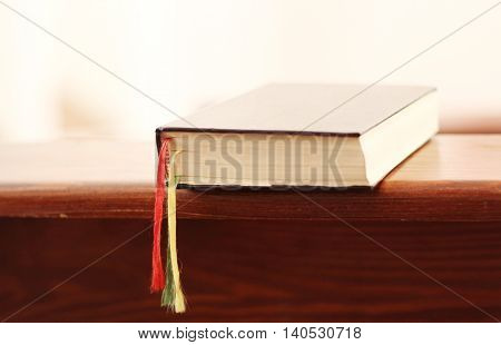 the prayer book on a bench in church; shallow depth of field