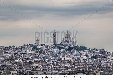 Sacre Coeur on the hill, skyline Paris.