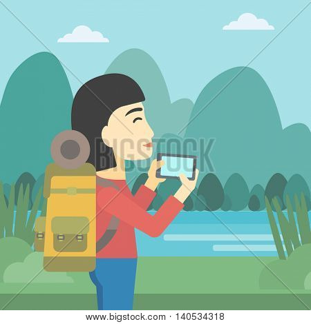 An asian woman taking photo of landscape with mountains. Young hiking woman with backpack taking photo with her cellphone. Vector flat design illustration. Square layout.