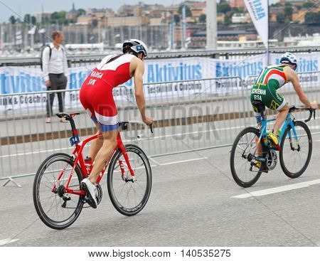 STOCKHOLM SWEDEN - JUL 02 2016: Side view of two male triathlete cyclist Richard Varga (SVK) and Henri Schoeman (RSA) in the Men's ITU World Triathlon series event July 02 2016 in Stockholm Sweden