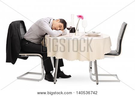 Drunk lonely man sleeping on a restaurant table isolated on white background