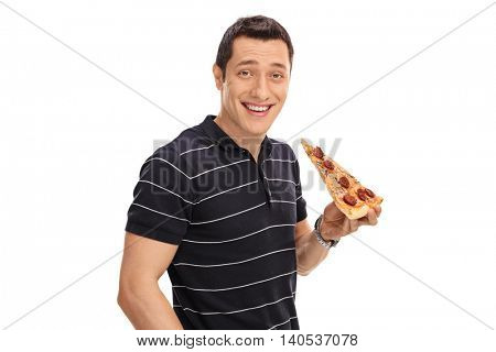 Young man having a slice of pizza isolated on white background
