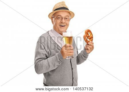 Cheerful senior holding a pretzel in one hand and a pint of beer in the other isolated on white background