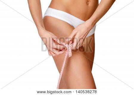 Torso of luxurious woman in white bikini studio shot