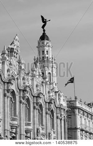 Gran Teatro in Havana Cuba with the fascade view and national cuba flag - bw