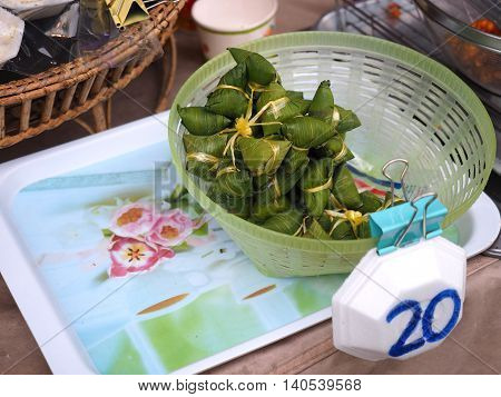 wrapped sweet Zongzi Chinese style Sticky Rice wrapped in Bamboo Leaves sell in market.