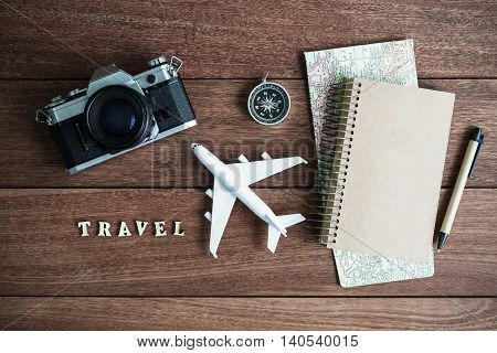 traveler planning trip on wooden background and copy space Travel concept