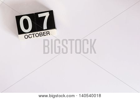 October 7th. Day 7 of month, wooden color calendar on white background. Autumn time. Empty space for text.