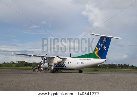 Honiara, Solomon Islands - May 27, 2015: Small propeller plane parked at the airport