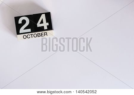 October 24th. Day 24 of month, wooden color calendar on white background. Autumn concept. Empty space for text.