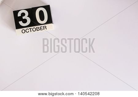 October 30th. Day 30 of month, wooden color calendar on white background. Autumn fall. Empty space for text.