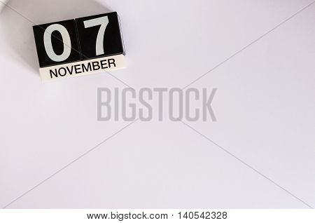 November 7th. Day 7 of month, wooden color calendar on white background. Autumn time. Empty space for text.