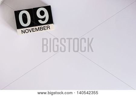 November 9th. Day 9 of month, wooden color calendar on white background. Autumn concept. Empty space for text.