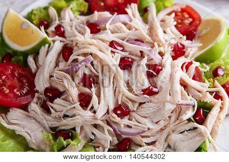 chicken white meat breast with lettuce tomato pomegranate