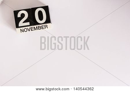 November 20th. Day 20 of month, wooden color calendar on white background. Autumn time. Empty space for text.