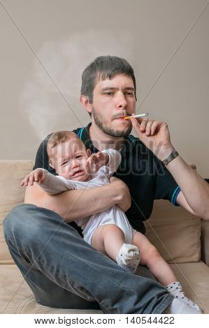 Bad Father Is Smoking Cigarette And Holding Baby.