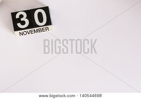 November 30th. Day 30 of month, wooden color calendar on white background. Autumn fall. Empty space for text.