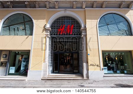 ATHENS-AUGUST 22: H&M store facade on Emrou street on August 222014 Athens Greece. H & M is a Swedish retail-clothing company known for its fast-fashion clothing for men women and children.
