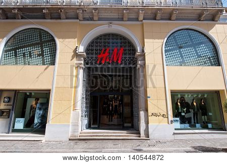 ATHENS-AUGUST 22: H&M store building on Emrou street on August 222014 Athens Greece. H & M is a Swedish retail-clothing company known for its fast-fashion clothing for men women and children.