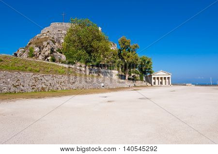 Southern side of the Old Fortress with the Church of St. George in the distance. Corfu Greece.