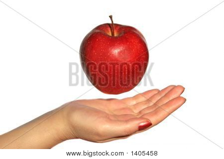 Apple Above A Hand
