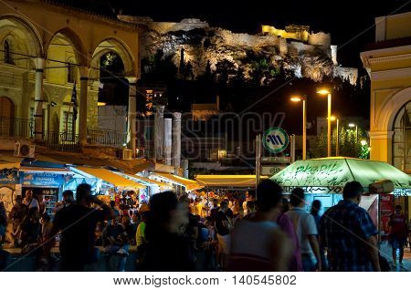 ATHENS-AUGUST 22: Nightlife on Monastiraki Square with Acropolis of Athens on the background on August 22 2014 in Athens Greece.
