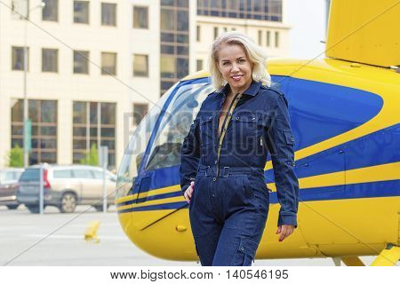 Pretty Pilot Woman On Helocopter Background