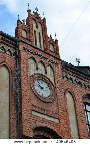 Clock on the old building of Art Academy in the gothic style in Riga, Latvia. Early 20th century.