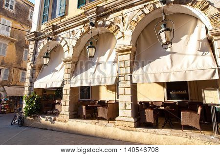 Cosy restaurant in of a typical Venetian building in Kerkyra city on the island of Corfu Greece.