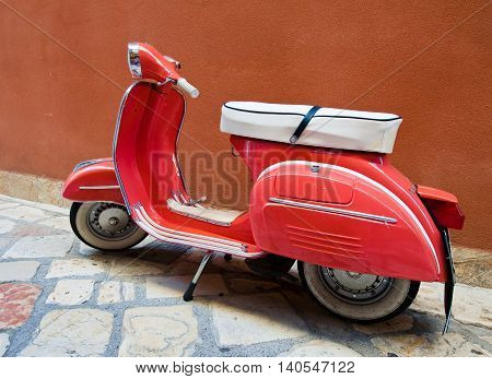 CORFU-AUGUST 22: Vintage Vespa scooter on Kerkyra street on August 22 2014 on Corfu island. Greece. Vespa is an Italian brand of scooter manufactured by Piaggio.