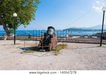 Antique Canon looking towards the seacoast inside the Old Fortress. Corfu islandGreece.