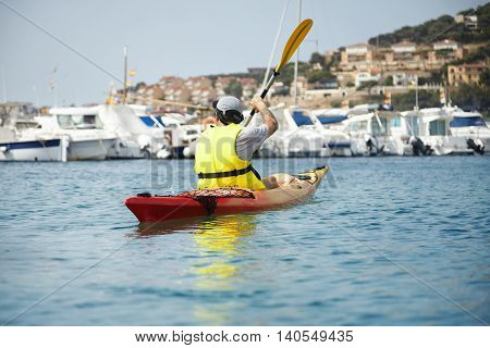 Fresh And Amazing Picture Of Kayaking Young Man In Yellow Safety Vest. Gorgeous Landscape Of Seaside