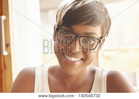 Nice Close-up Portrait Of Young Girl In Geeky Glasses With Pixie Cut. Intelligent Spanish Woman With