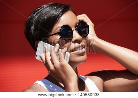 Outdoor Headshot Of African American Woman Entrepreneur Talking On Smart Phone With Her Dentist, Arr
