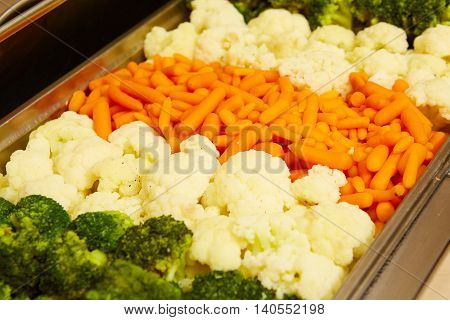 steamed vegetables in a dining room at breakfast in the hotel.