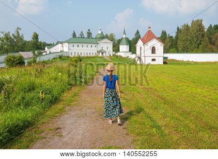 Little girl walking along a rural country road to the temple