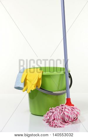 bucket with mop on the white background