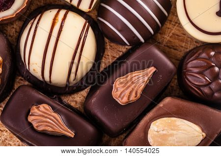 Pralines On Wooden Surface