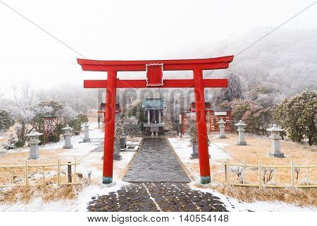 Close up of beautiful red wooden torii in japanese shrine on kumamoto moutain japan.