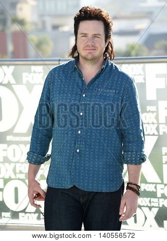 LOS ANGELES - JUL 22:  Josh McDermitt arrives to the Comic Con 2016 - The Walking Dead PhotoCall on July 22, 2016 in San Diego, CA