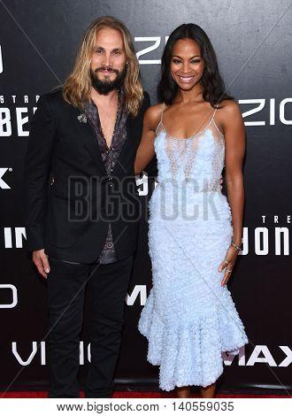LOS ANGELES - JUL 20:  Zoe Saldana & Marco Perego arrives to the