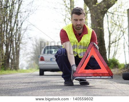 Man Fixing A Car Problem After Vehicle Breakdown