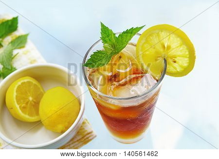 Glass of iced tea with lemon and fresh mint