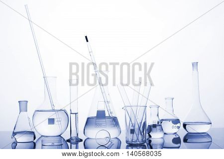 Test-tubes On A White And Blue Background.