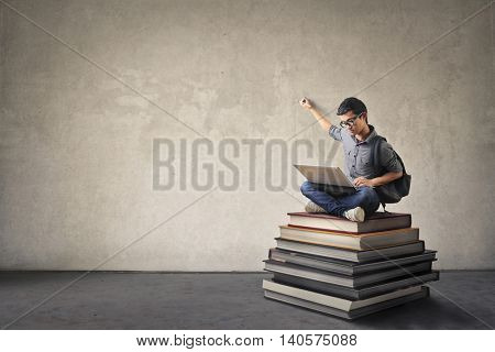 Student writing on a blank wall
